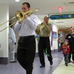 "Jim and Bob play ""When the Saints Go Marching In"" as patients and their families march in CHP's Mardi Gras parade."