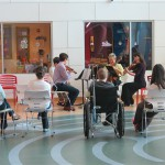 A string quartet of PSO musicians plays for patients and their families during a May 2014 Mother's Day event at CHP.