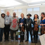 Veterans and staff at the VA Pittsburgh's H.J. Heinz Campus pose with a PSO string quartet after a holiday musical event in December 2014.