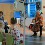Anne serenades two CHP patients during the book reading.