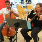 PSO violist Penny Brill and a PYSO cellist play for children and families attending the October 2012 Fiddlesticks and Pancakes breakfast at CHP.