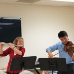 The PSO's Principal Flute, Lorna McGhee, and violist Meng Wang play for veterans participating in a September 2012 cognitive therapy session at the VA.
