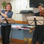 Ths PSO's Principal Flute, Lorna McGhee, and Principal Second Violin, Jennifer Ross, play during a November 2013 cognitive therapy session at the VA.