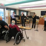 PSO musicians Chad Winkler, Neal Berntsen, Peter Sullivan, and Jim Nova play holiday tunes for a group of veterans at the VA in December 2012.