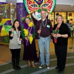Gloria Mou, PSO Director of Musician and Community Engagement Programs, poses with PSO musicians, as well as CHP Music Therapist Deborah Benkovitz, at the February 2012 Mardi Gras event.
